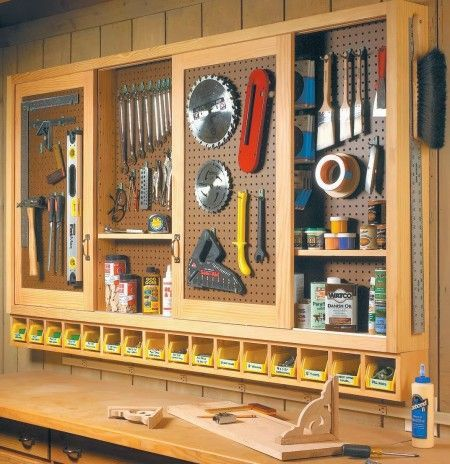 Perfect for our workroom off the garage: Build an Organized Pegboard Tool Cabinet and Simple Workbench Love the little cubbies under the hanging cabinet for hardware.