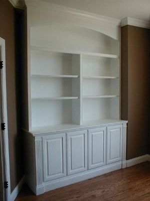 Built in Bookcase and Cabinets. I like the arch to match our doorway.