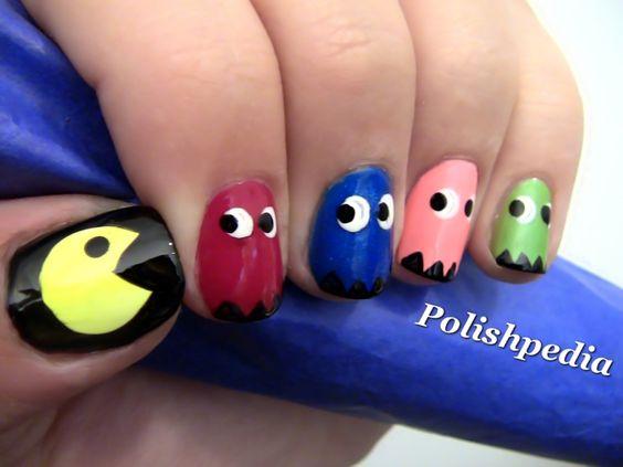 Geek nail art! http://www.polishpedia.com/images/pac-man-nail-art.jpg