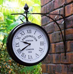 "Outdoor Garden Clock - Paddington - 27cm (10.5"") > Weather resistant black metal casing Large roman numerals with 2 quartz movement Double-sided - Traditional compact design"