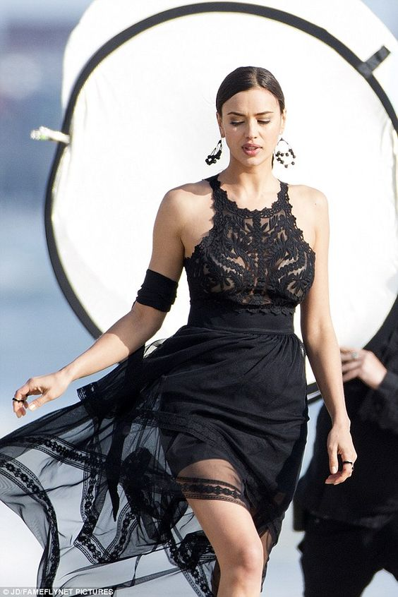 Peek-a-boo! The flirty frock's lacy bodice revealed just a hint of Irina's nude bra underneath