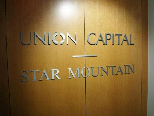 custom 14 thick satin aluminum metal letters pin mounted to wooden wall paneling