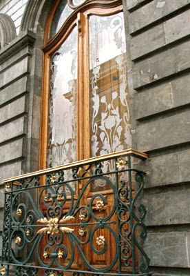 Beautiful balcony and etched glass French doors.  I love the glass, I love the shape of the doors and I love the iron work!!