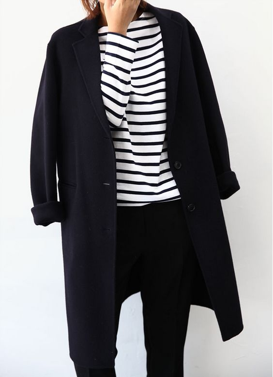 Style inspiration for fall and winter: black and white stripes, black coat, black pants. Chic outfit idea, street style fashion
