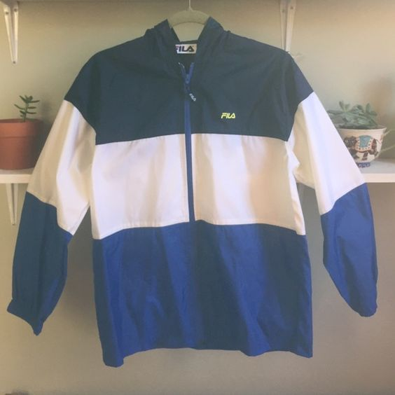 vintage 90s FILA rain jacket NWT Vintage Fila blue and white stripped rain jacket with hood size large can fit a small women oversized Fila Jackets & Coats