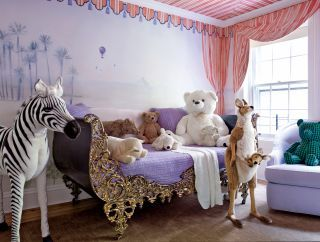 A romantic, fairytale-esque kid's room filled with exotic stuffed animals. | architecturaldigest.com Photo by William Waldron