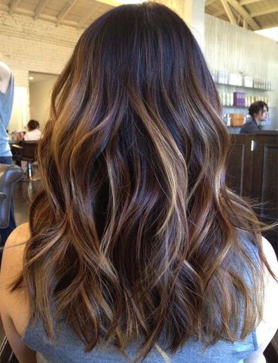 Medium-length, dark brown hair with balayage.
