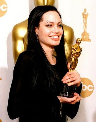 "3/7/14 12:48a The Academy Awards Ceremony 2000:    Angelina Jolie  Best Supporting Actress Oscar for ""Girl, Interrupted""  1999."
