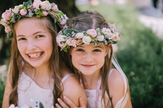The rose bud floral crowns make the girls look like forest fairies | Love My Dress® UK Wedding Blog