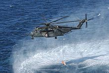 """The Navy requested a version of the CH-53E for the airborne mine countermeasures role, designated """"MH-53E Sea Dragon"""". It has enlarged sponsons to provide substantially greater fuel storage and endurance. It also retained the in-flight refueling probe, and could be fitted with up to seven 300 US gallon (1,136 liter) ferry tanks internally. The MH-53E digital flight-control system includes features specifically designed to help tow minesweeping gear.The prototype MH-53E made its first flight…"""