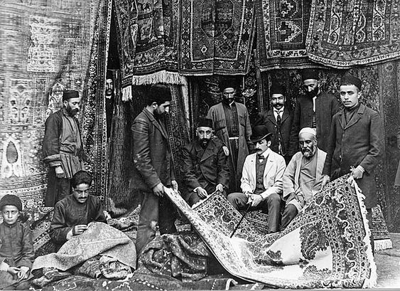 A Russian customer buying carpets from a Persian merchant