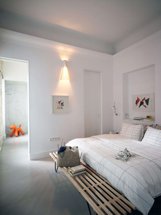 I love the cool gray ceiling and porcelain tile floor in this apartment in Paris by ASKarchitects