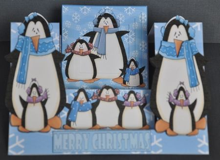 I just love the eyes on these penguins!  I printed the design onto good quality white card and cut out all the elements.  I inked the edges of all the decoupage elements and, following the very clear directions, assembled the card using spongy tape.   A very cool card that will compliment all other Christmas decorations for years to come