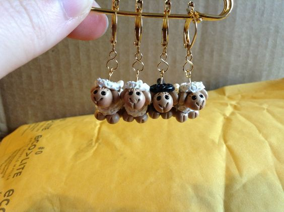 The stitch markers from The Clay Sheep I received for winning Fan's Choice in Round 3 of Battle of the Stitches! The lone black one is my favorite! (Mr. Blacksheep and Mrs. Blackstone...match made in heaven hehe) #theclaysheep #stitchmarkers #crochet #clay