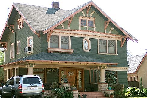 Two Toned Green Exterior With Cream Trim And Peach Colored