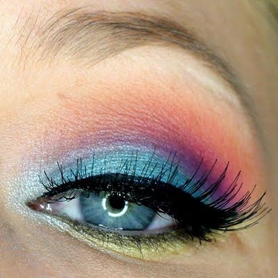 This look uses eye shadow in the bright colors of the rainbow - blue, purple, red, and orange, with yellow eyeliner. This gorgeous night out look pairs well with neutral or pink lips!: