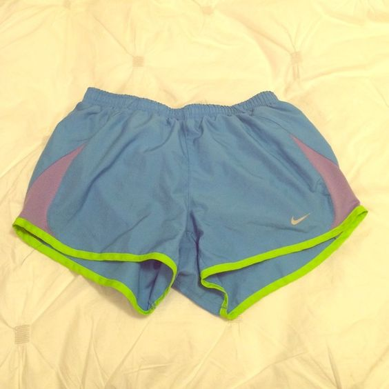 Blue Nike running shorts Blue shorts with green and purple Nike Shorts