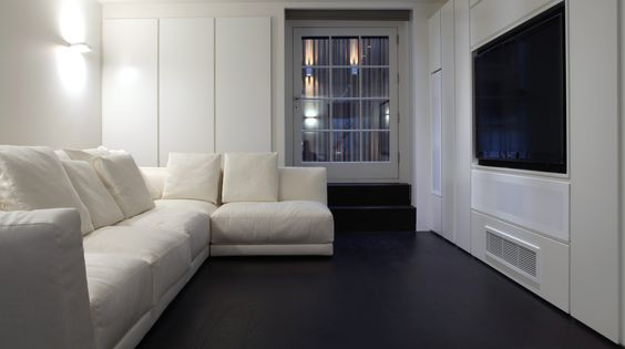 Dark nero oak flooring and white sofas