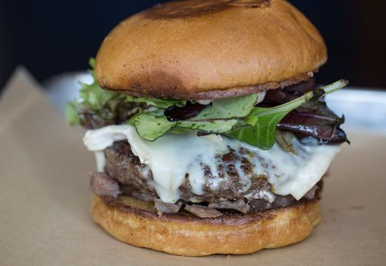 The Powerslave (burger with creamy brie, bourbon apple compote, balsamic aioli, field greens.)