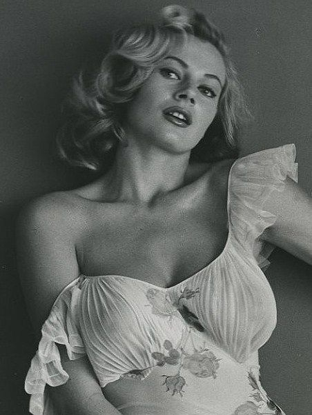 Anita Ekberg. Film actress. Kerstin Anita Marianne Ekberg is a Swedish actress, model, and sex symbol. She is best known for her role as Sylvia in the Federico Fellini film La Dolce Vita, (The Sweet Life, 1960), which features a scene of her cavorting in Rome's Trevi Fountain alongside Marcello Mastroianni. Wikipedia: