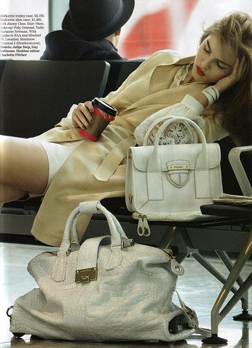 How to look fab when sleeping at the airport? Carry lots of Prada! (and hope it doesn't get stolen)