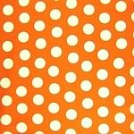 white on orange polka dot fabric