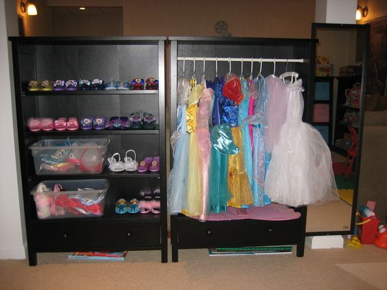 organizing dress up, bookcase turned clothes rack? Hang neckless ect. on the sides? bottom drawer/shelf with baskets for other accessories