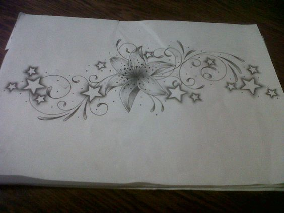 lily tattoo design with swirls and stars by *tattoosuzette on deviantART