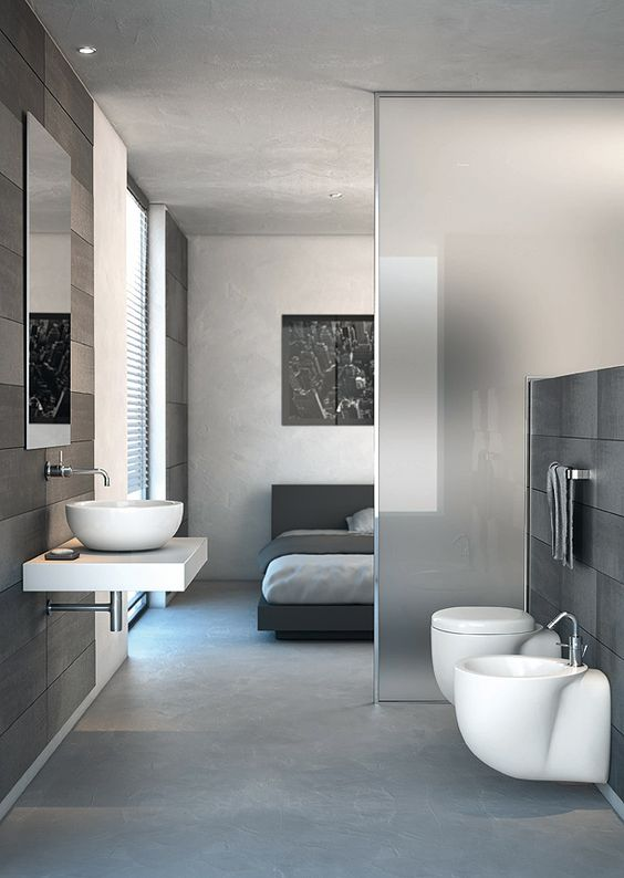Chic Modern Studio Apartment - bathroom & bedroom separated with the frosted glass panel. Strada Collection by Ideal Standard