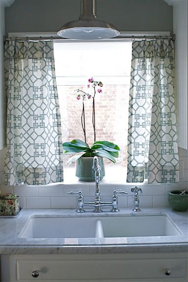 """new apt: no sew kitchen window treatment!  get some fabric, iron on """"heatnbond hem"""" adhesive, get a super cheap curtain rod from target and add some rings with clips!  DONE!"""