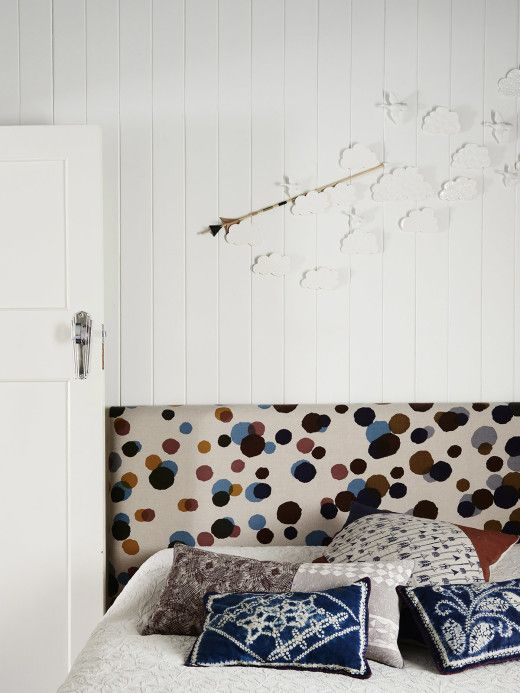 Bedroom. Queensize bed with a bed head Kylie had custom made with a Mina Perhonen fabric purchased in japan, with Nancy Bird and handmade shibori cushions. The wall behind has ceramic cloud wall pieces made by Kylie, and the arrow is by Georgie Cunningham Design. Photo – Eve Wilson, production – Lucy Feagins / The Design Files.