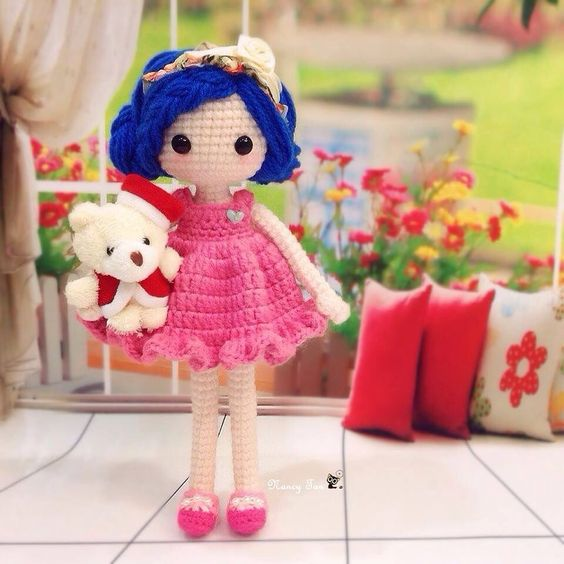 Pretty dolly which I named her Sugar  Pink dress and Blue hair with flowery hairband ~ What a nice match