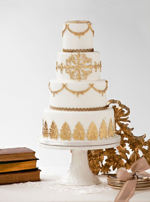 Bobbette & Belle A Royal Affair wedding cake. An otherwise simple four tier structure becomes a cake fit for a queen with baroque sugar details painted with 24 kt gold. Silver or bronze would be sophisticated alternatives @Four Seasons Bridal:
