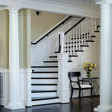 Notice the moulding on the open side under the stairs