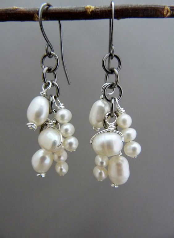 Gorgeous natural pearl, dangle earrings wrapped with non tarnishing silver plated wire. Hung on gunmetal gray jump rings and handmade gunmetal ear wires. MEMBER - GHdesigns