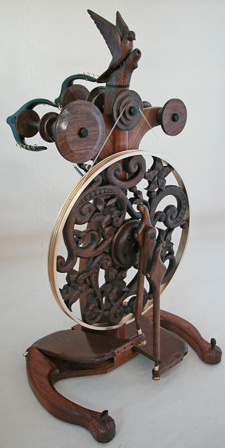 Hand carved, exquisite, triple flier, walnut and ebony spinning wheel.: