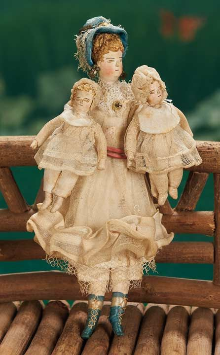 Early Miniature cloth family of mother and two babies in original costumes - 5 1/2""