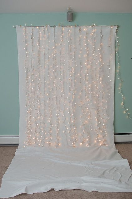 I see this pinned all the time as a suggestion for a photo booth backdrop, but Id like to do a whole wall like this, minus the floor part, only with the lights hanging behind the fabric, hiding the wires and softly filtering the lights. Seems like a nice lovely glow for a bedroom. use seaglass colors:
