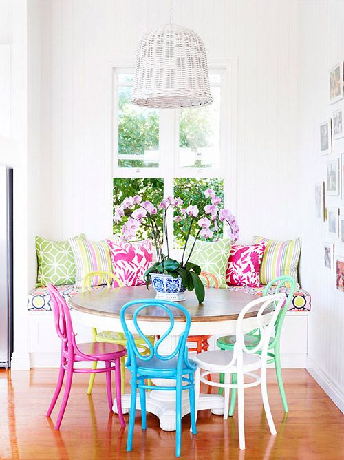 If I can bear to paint the base of the pedestal table, this might be a good look (oh, do some candy coloured chairs!)