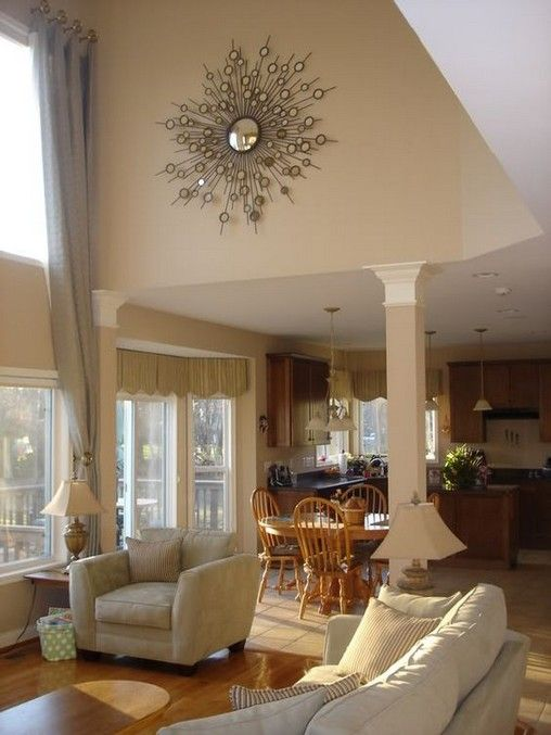 Tips To Decorate A Large Wall With Vaulted Ceilings Family Room Wall Decor Family Room Decorating Room Wall Decor
