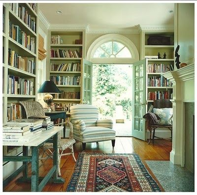 Library room with comfy places to sit and read in the sun. Maybe a bay window and window seat
