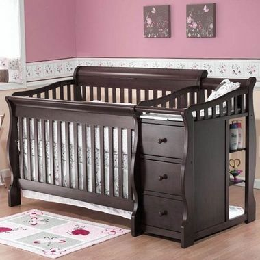 Attached changing station turns to a nightstand when the crib converts to a bed. Smart!