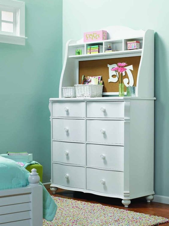 great dresser for a teen's room with a cork-board back!