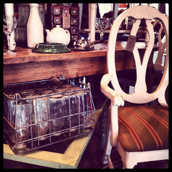 metal milk crate with glass bottles, white chair