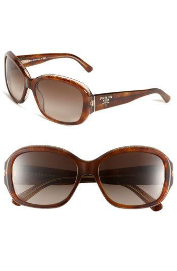 Sometimes fancy sunglasses are worth the splurge. Love Prada.