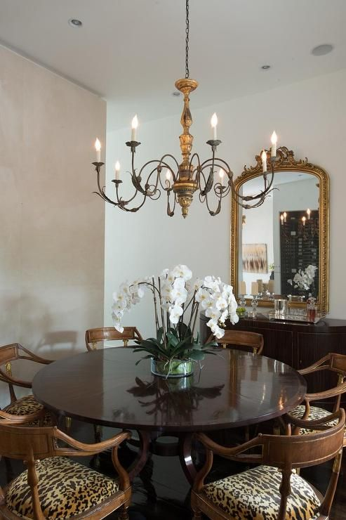 chic french dining room features a candle chandelier illuminating a
