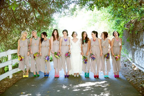Bridesmaid jumpsuits and bright shoes for a pretty pop of color! | Mandilynn Photography