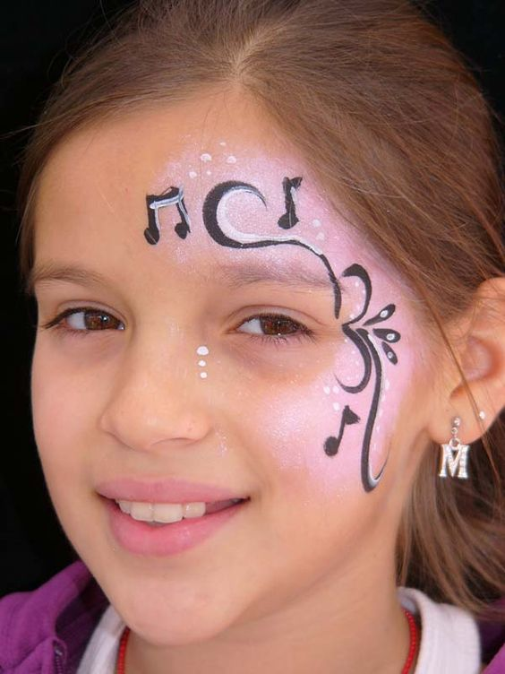 Facepainting.  Music notes.  Very sweet and I love the little white dots beneath the eye.  Kudos to the original painter!