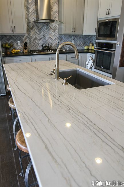 This piece of quartzite has some relatively stable veining all the way through. It also goes well with the darker countertops on the cupboards behind as an accent.