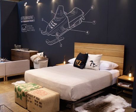 Canadian design show, booth staged with simple masculine design ideas for a bedroom. Teen boyz would love the black wall chalkboard Painted wall with the snowmobile or what ever they want on their wall. So Canadian eh!